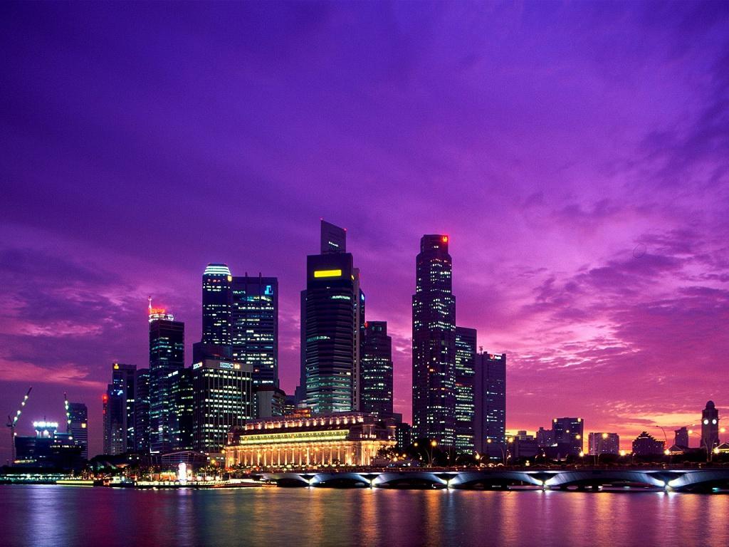 Città notte sera luci insegne ponte luminose grattacieli grattacielo