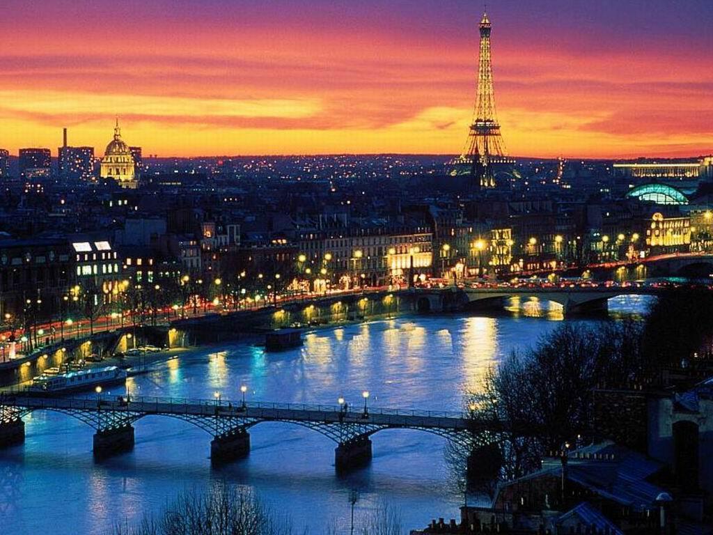 Torre eiffel notte ponte giallo blu azzurro rosso nero architettura